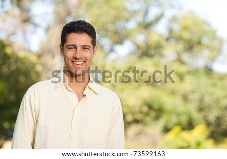 Handsome man in the park - stock photo