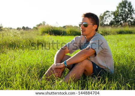 Handsome man in the park. Funny shot - stock photo