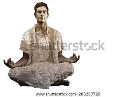 Handsome man in white meditating in lotus pose against trees in the autumnal forest - stock photo