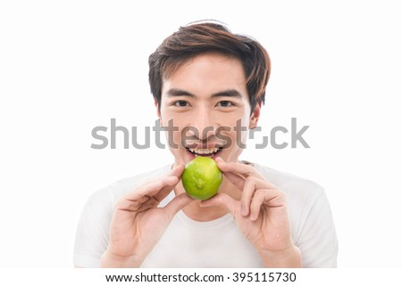 handsome man in white shirt with green lime  - stock photo