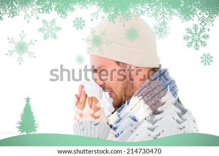 Handsome man in winter fashion blowing his nose against snowflakes and fir tree in green - stock photo