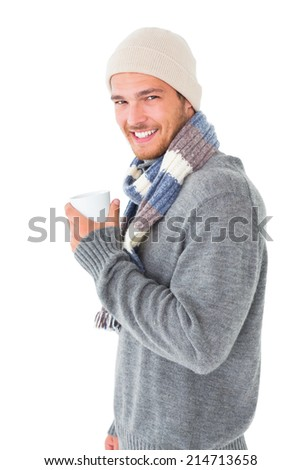 Handsome man in winter fashion holding mug on white background - stock photo