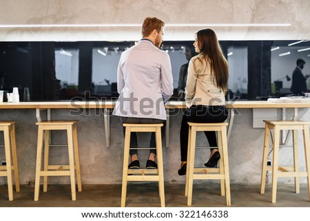 Handsome man initiating a conversation in a bar - stock photo