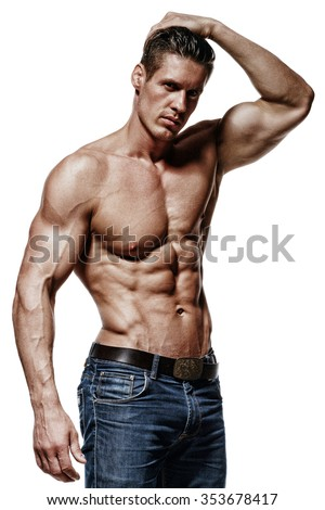 Handsome man is flexing his bicep. He is looking at the camera. Isolated on background
