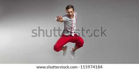 Handsome man jumping with vigor - stock photo
