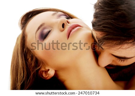 Handsome man kissing woman's neck with desire. - stock photo