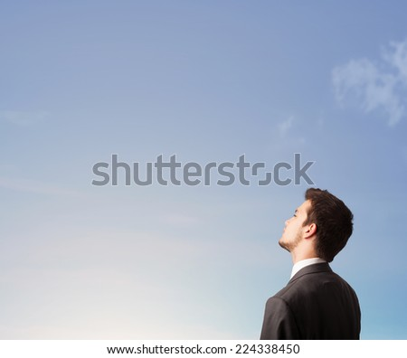 Handsome man looking at the blue sky copyspace concept - stock photo