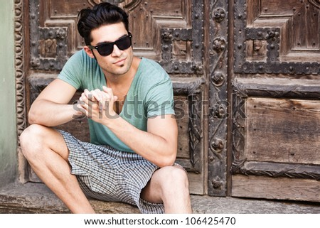 handsome man looking serious wearing sunglasses - stock photo