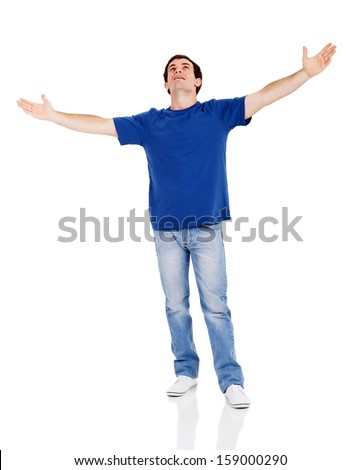 handsome man looking up with his arms wide open isolated on white - stock photo