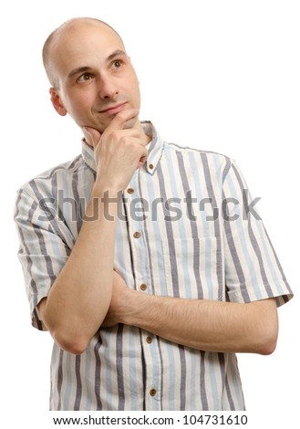 handsome man looking upwards and thinking - stock photo