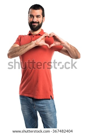 Handsome man making a heart with his hands - stock photo
