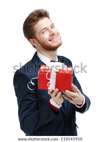 Handsome man offers a present wrapped in red gift paper, isolated on white - stock photo