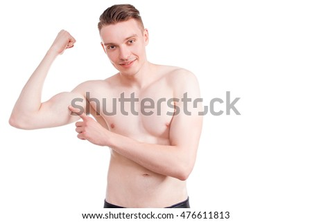 Handsome man on a white background with a naked torso in blue jeans