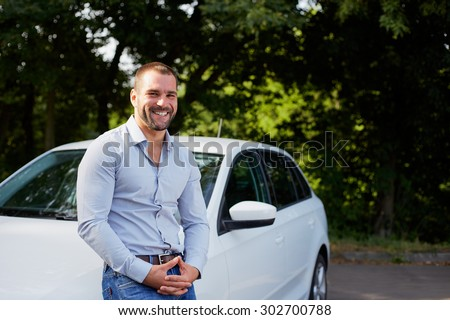 Handsome man on the background of car - stock photo