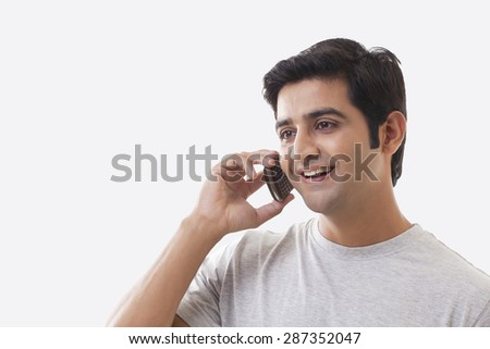 Handsome man on the phone over white background