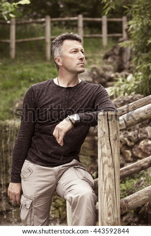 Handsome man. Outdoor male portrait. Image toned. - stock photo