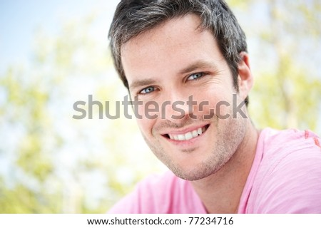 Handsome man outdoors - stock photo