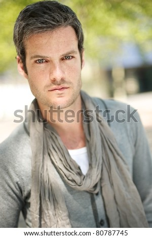 Handsome man outdoors smiling - stock photo