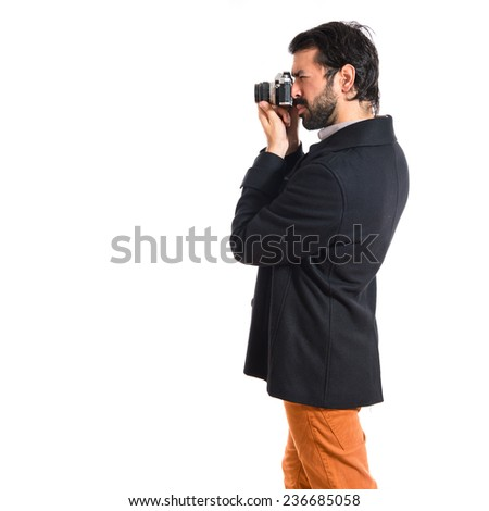 Handsome man photographing something