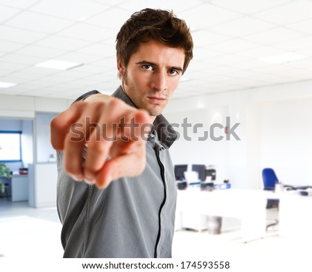 Handsome man pointing his finger to you. Isolated on white - stock photo
