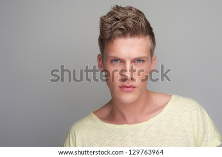 Handsome man portrait against gray background - stock photo