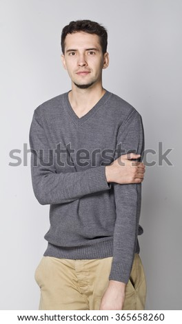 Handsome man portrait with grey sweater.