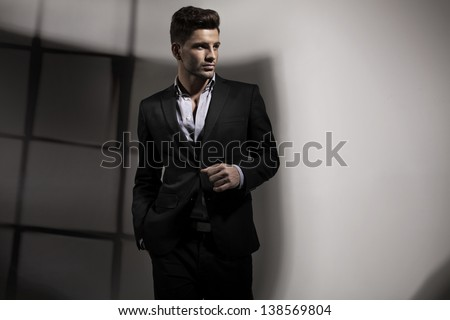Handsome man posing - stock photo