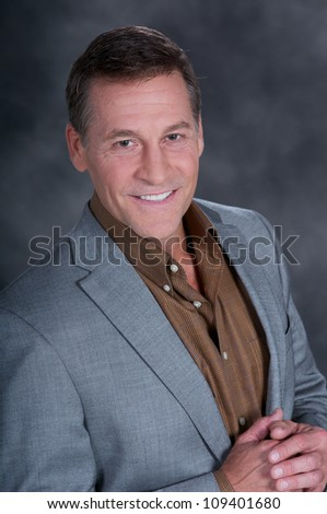 Handsome Man Posing For Studio Portrait in a jacket