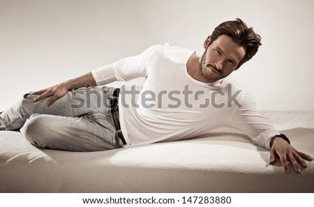 Handsome man posing in studio - stock photo