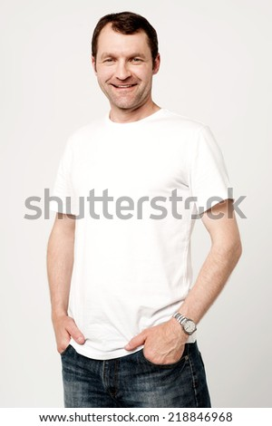 Handsome man posing with hands in pockets