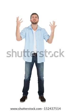 Handsome man posing with hands up on white background - stock photo