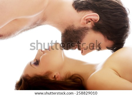 Handsome man pretending to kiss woman's neck. - stock photo