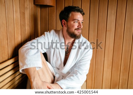 Handsome man relaxing in sauna and staying healthy - stock photo