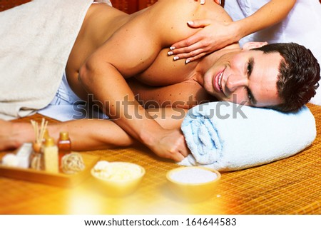 Handsome man relaxing in spa massage salon.