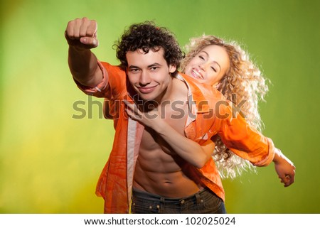 handsome man rescue his girlfriend - stock photo