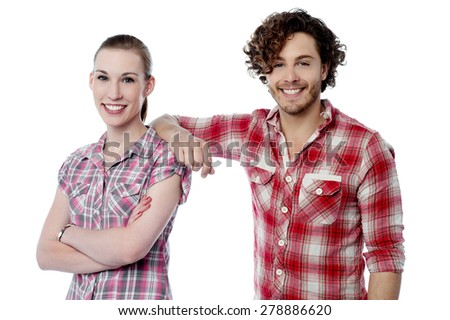 Handsome man resting his arm on girlfriend - stock photo
