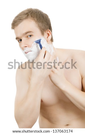 Handsome man's portrait made during shaving on white background - stock photo