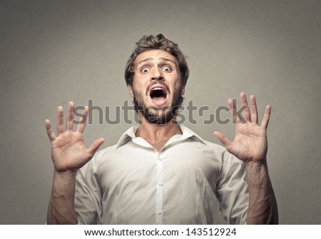 handsome man scared - stock photo