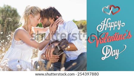 Handsome man serenading his girlfriend with guitar against cute valentines message - stock photo