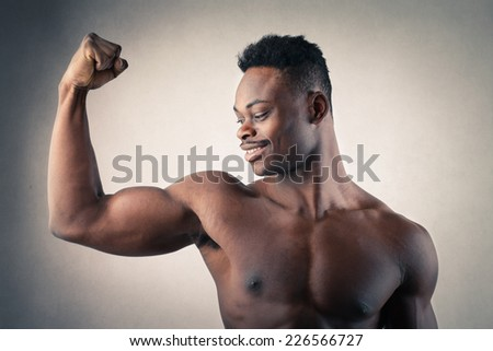 Handsome man showing off his muscles