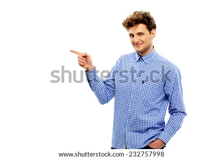 Handsome man showing something to the side - stock photo