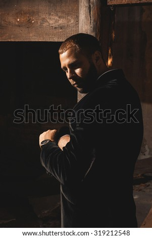 Handsome man silhouette in warm tones - stock photo
