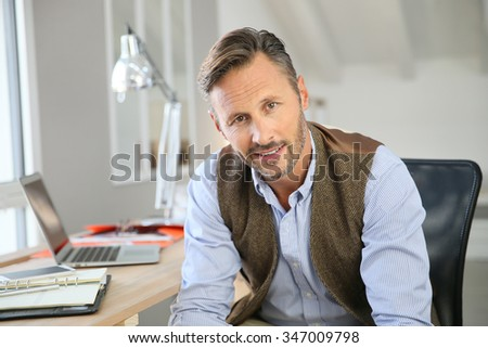 Handsome man sitting in office