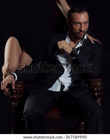 Handsome man sitting on the throne  - stock photo