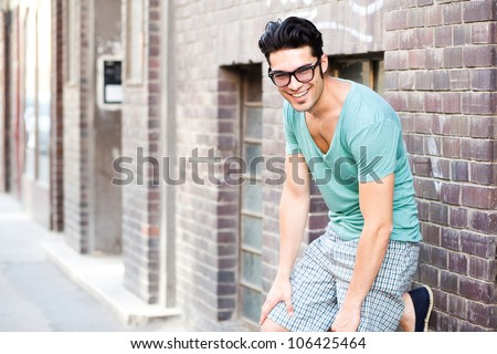 handsome man smiling on the street - stock photo