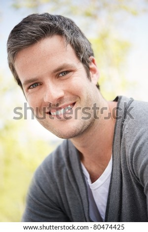 Handsome man smiling portrait - stock photo