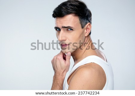 Handsome man standing over gray background - stock photo