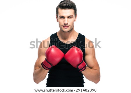 Handsome man standing with boxing gloves isolated on a white background. Looking at camera - stock photo