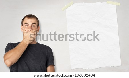 handsome man surprised and wondered man and blank paper on white background - stock photo