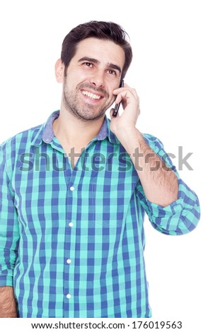 Handsome man talking on cell phone, isolated on a white background